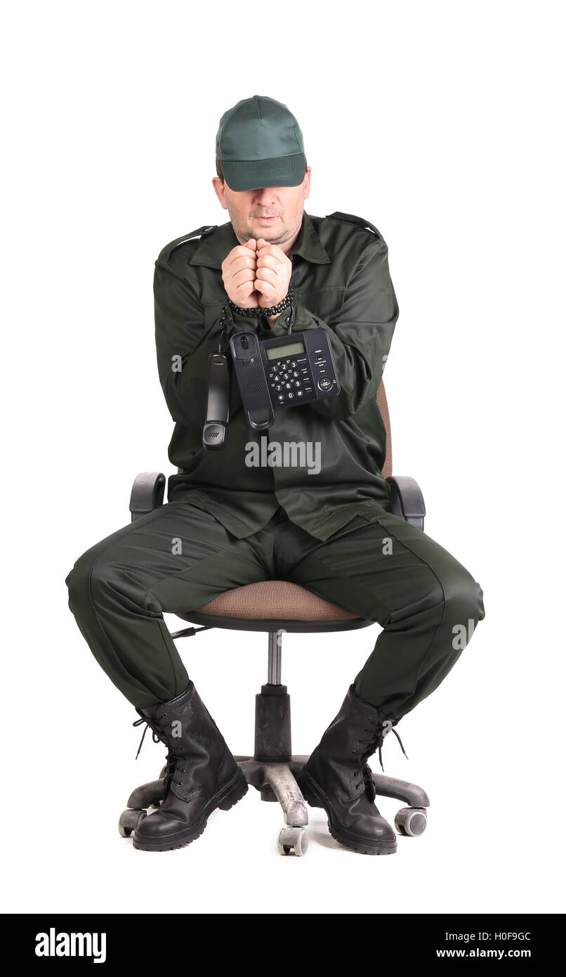 Man in workwear tied up with phone. - Stock Image