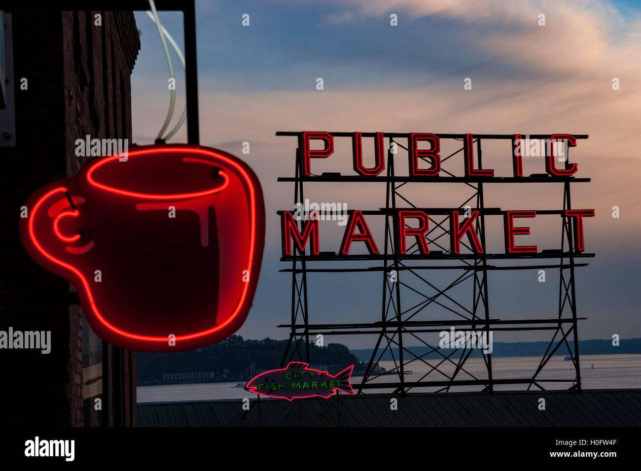 Neon sign for the Pike Place Public Market at twilight in Seattle, Washington. - Stock Image