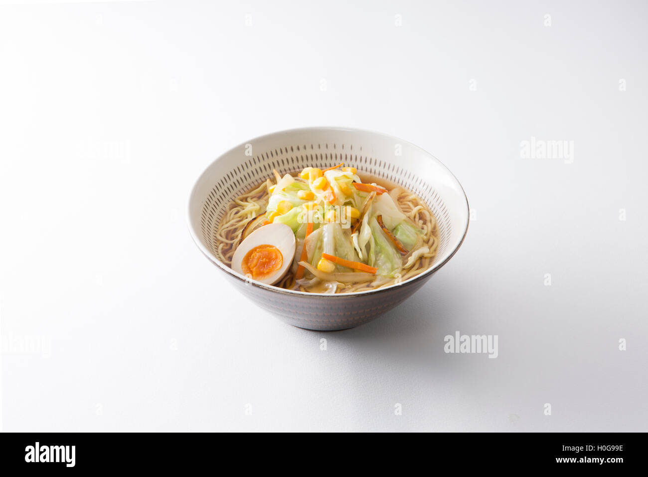 Japanese Koishiwara grilled ramen bowl with egg, cabbage, noodle and corn on white background - Stock Image