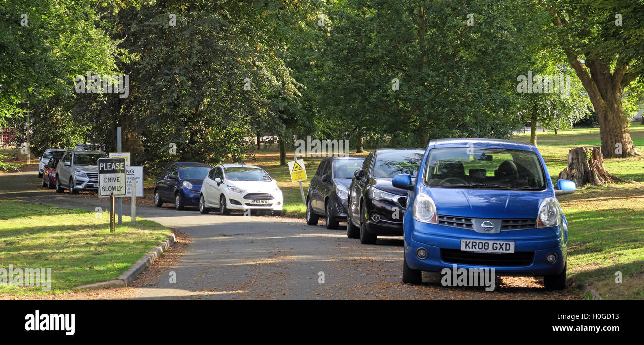 Parked cars, Grappenhall Hall School, Grappenhall Village, Warrington, Cheshire, England, WA4 3EP - Stock Image
