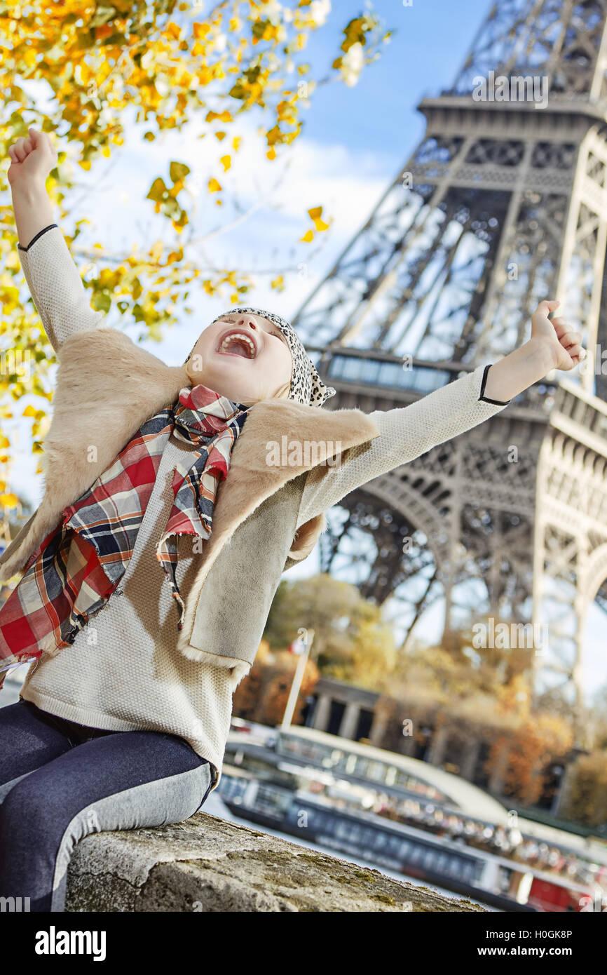 Having fun time near the world famous landmark in Paris. smiling elegant child on embankment in Paris, France rejoicing - Stock Image
