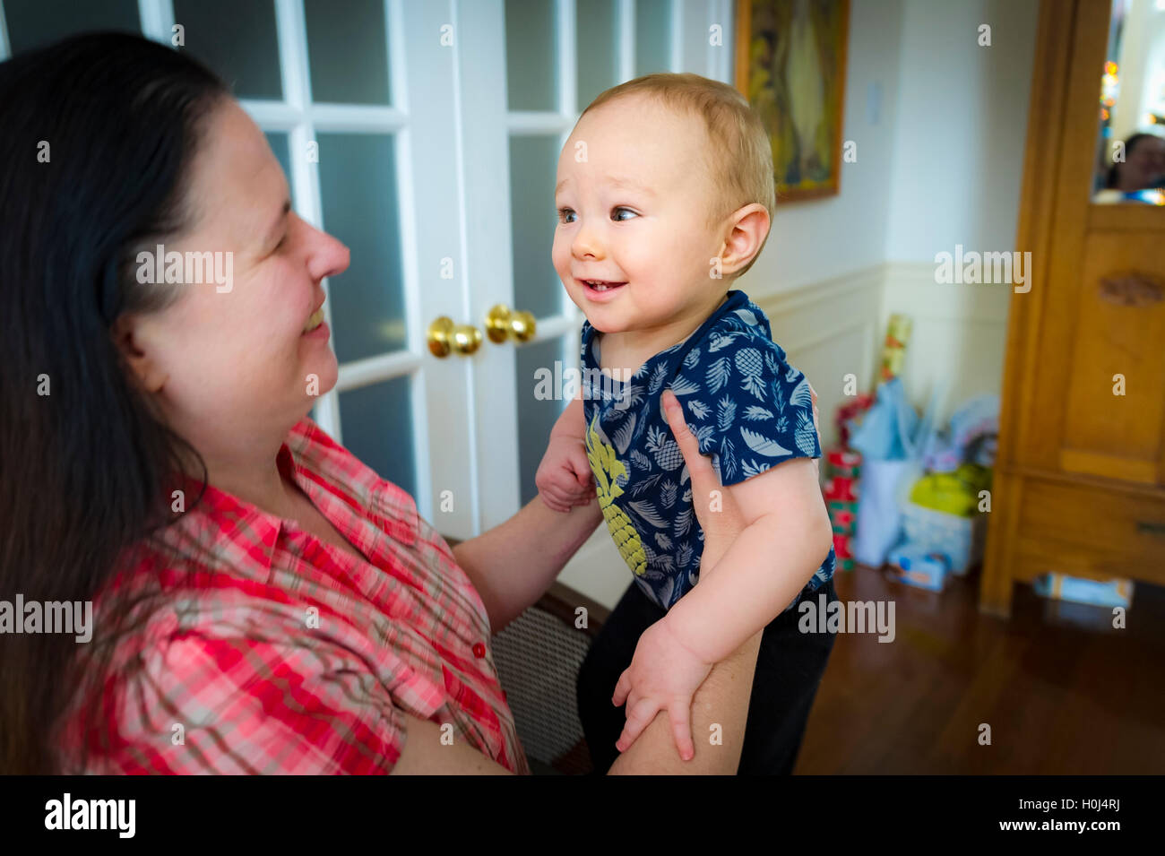 Woman playing with 9 months old grandson - Stock Image