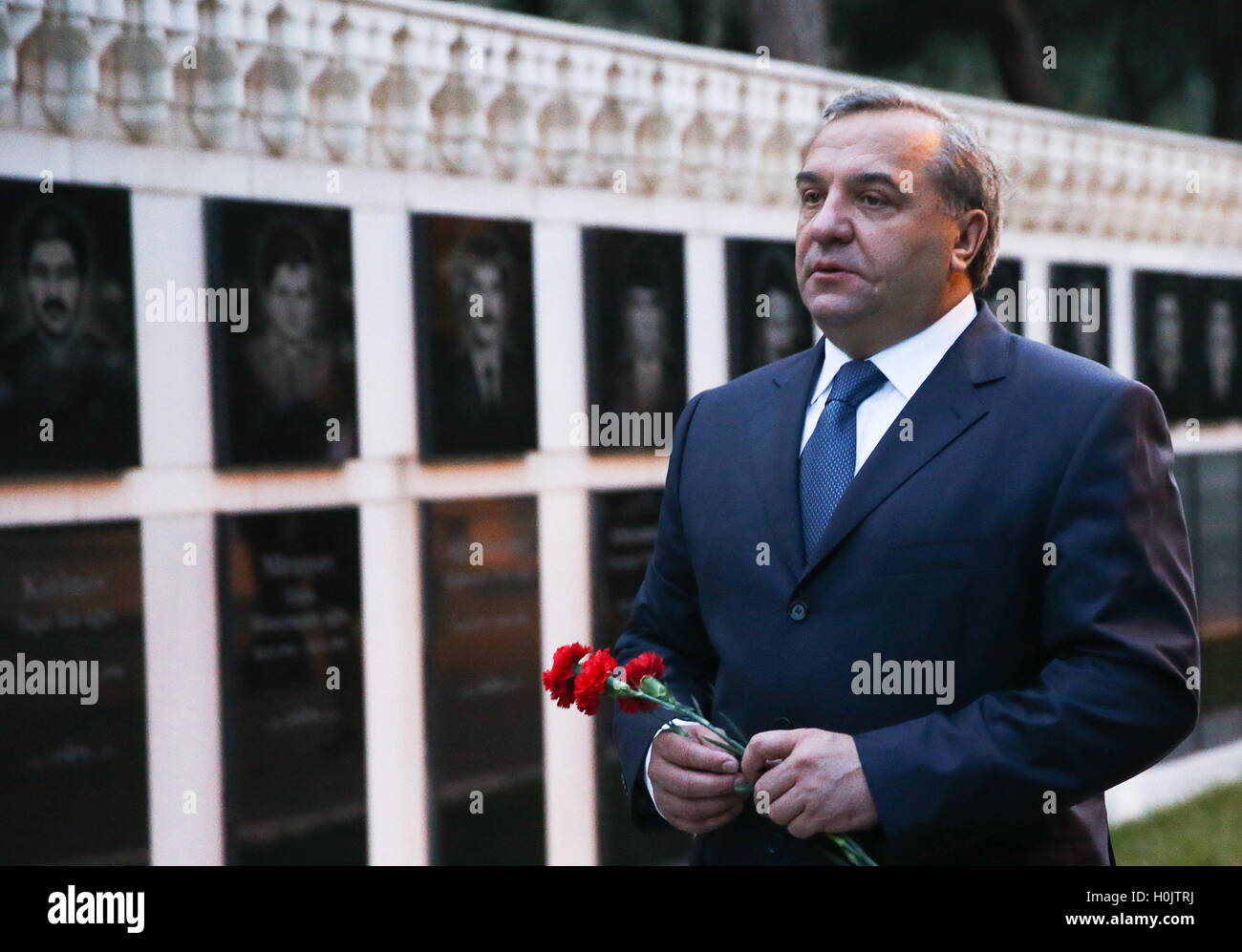 Baku, Azerbaijan. 20th Sep, 2016. Russia's Emergency Situations Minister Vladimir Puchkov lays flowers at the Martyrs' Stock Photo