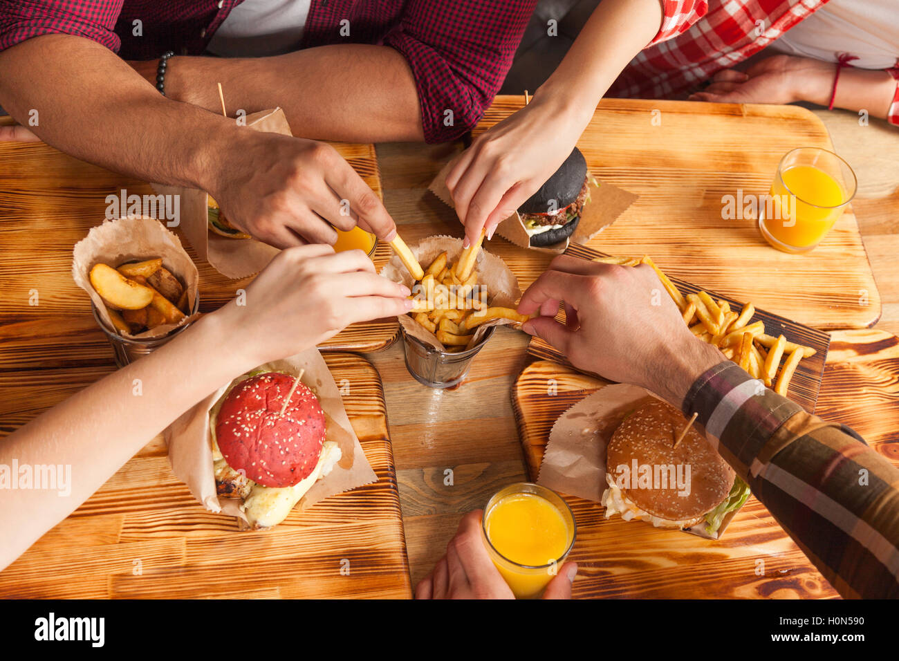 People Group Friends Hands Eating Fast Food Burgers Potato Drinking ...