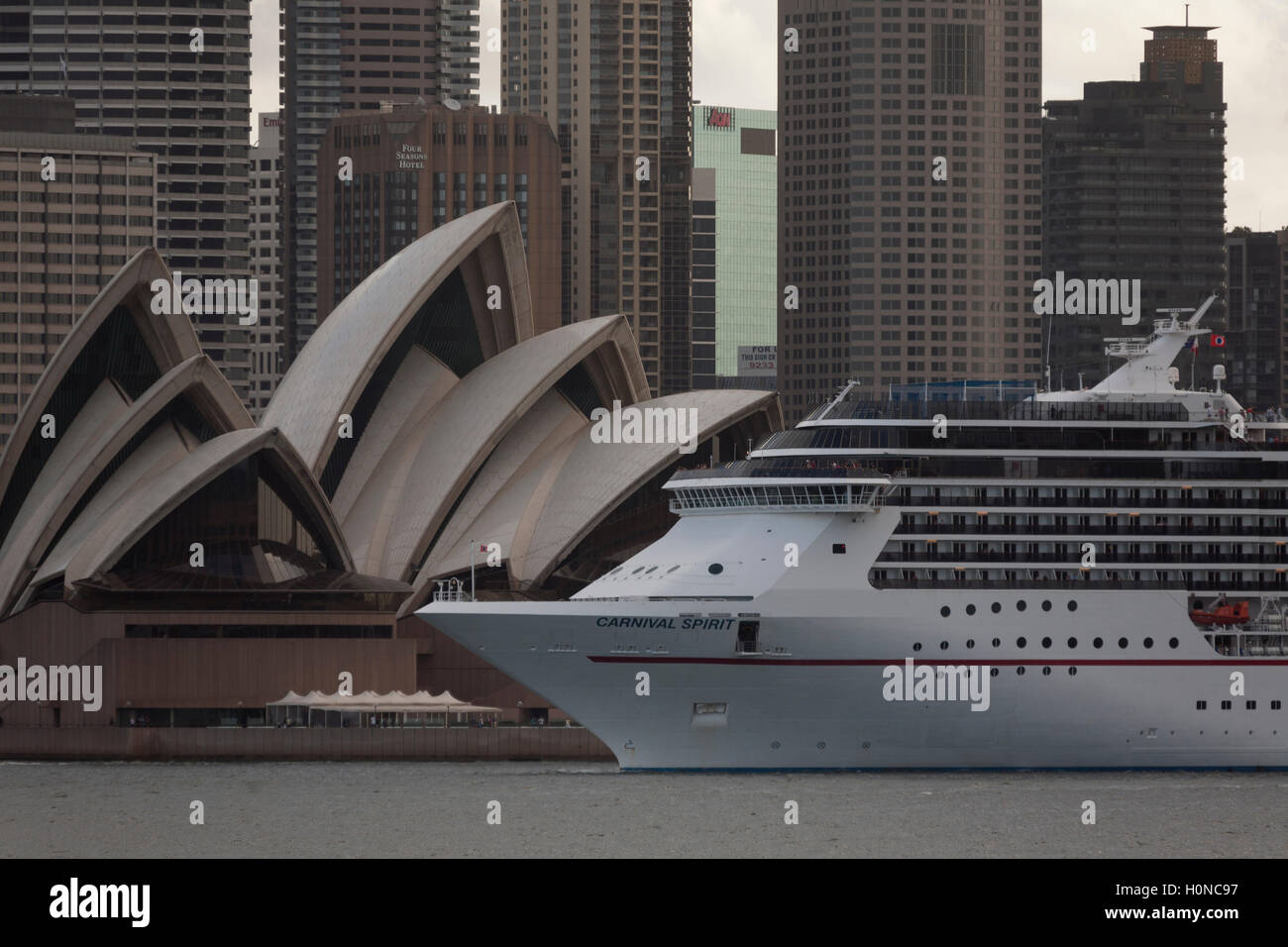 The Carnival Spirit Cruise Ship passes directly in front of the Sydney Opera House as she departs Sydney Australia Stock Photo