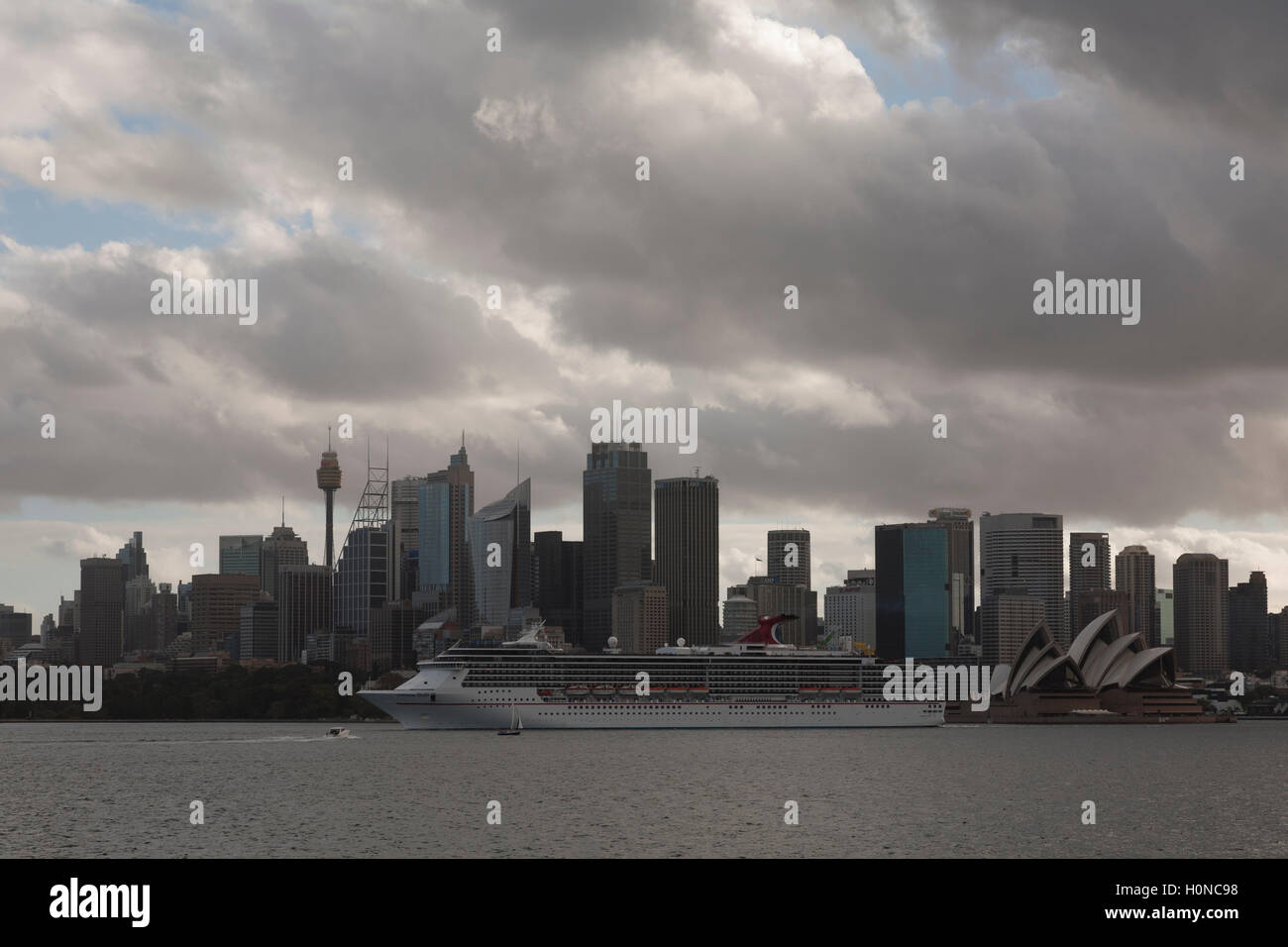 The Carnival Spirit Cruise Ship passes directly in front of the Sydney CBD as she departs Sydney Australia Stock Photo