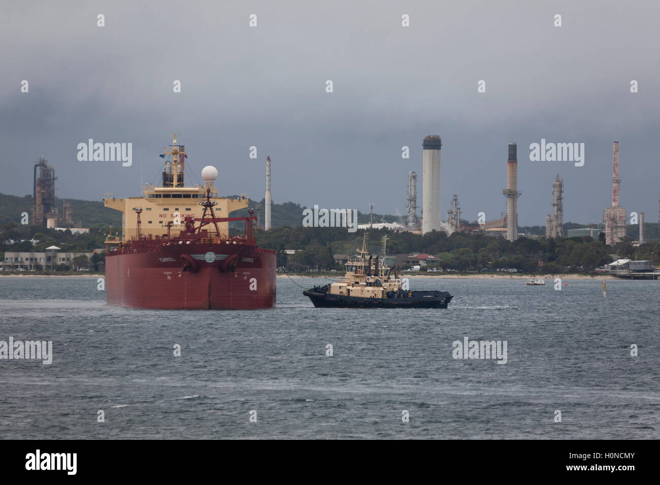 The fully loaded Turmoil Bulk Fuel Tanker arriving with the assistance of harbour tugboats at Kurnell Oil Refinery - Stock Image