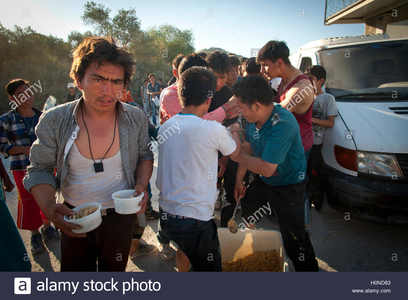 Scuffles broke out at Moria Registration Camp when it became apparent  food provided by volunteers would not be - Stock Image