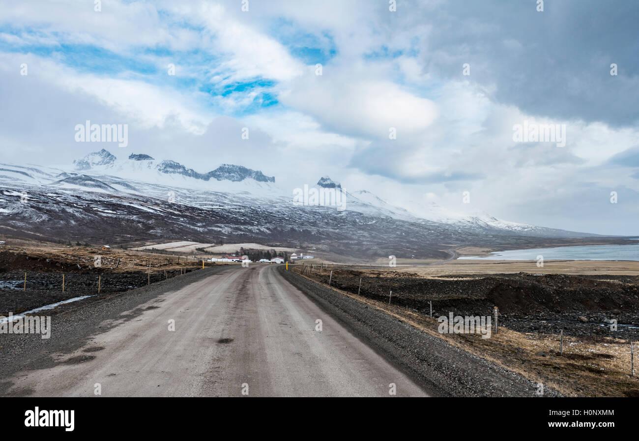 Road through volcanic landscape, ring road, National Highway 1 or Hringvegur, near Djúpivogur, East Island, Island Stock Photo