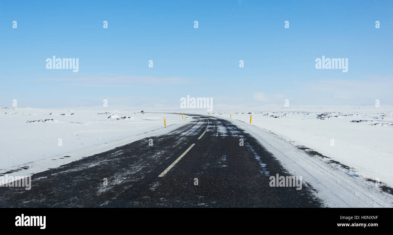 Road through snowy landscape, ring road, National Highway 1 or Hringvegur, North Island, Island - Stock Image