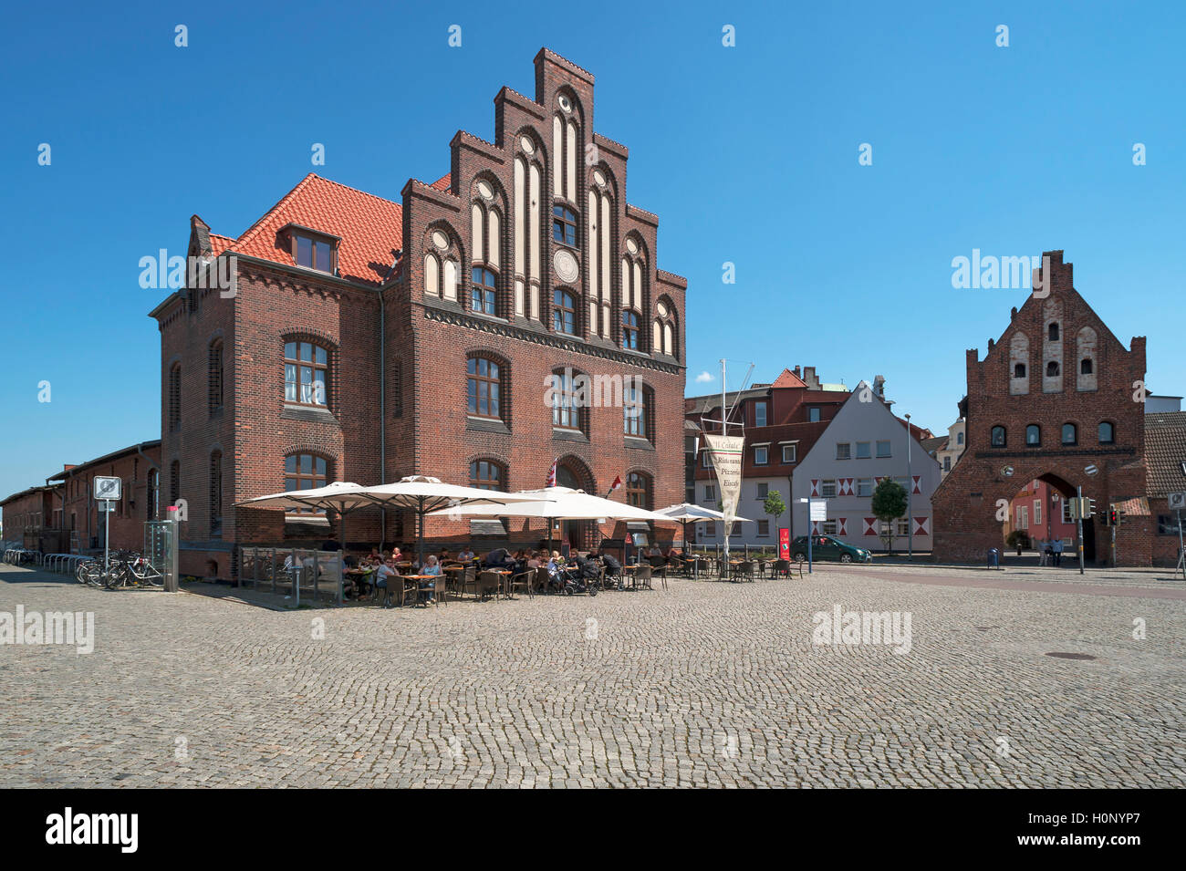 Old customs house with water gate in the Old Port, Wismar, Mecklenburg-Western Pomerania, Germany - Stock Image