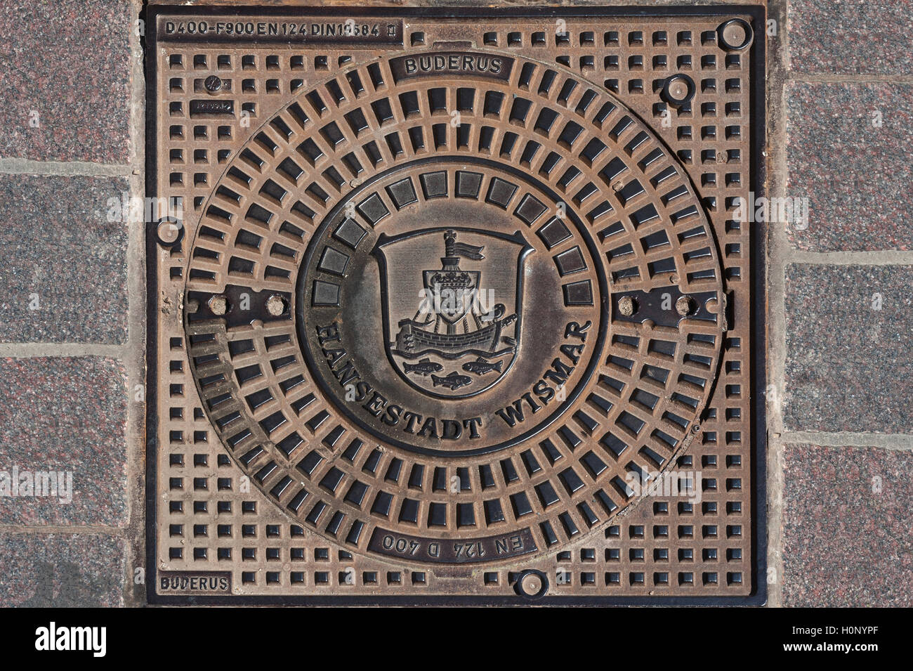Manhole in Wismar, Wismar, Mecklenburg-Western Pomerania, Germany - Stock Image