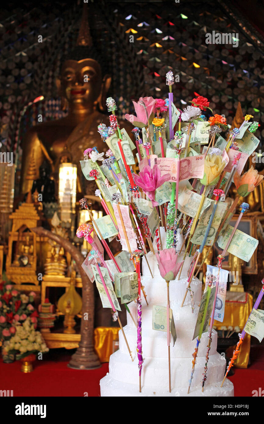 Money Donations In A Thailand Temple - Stock Image