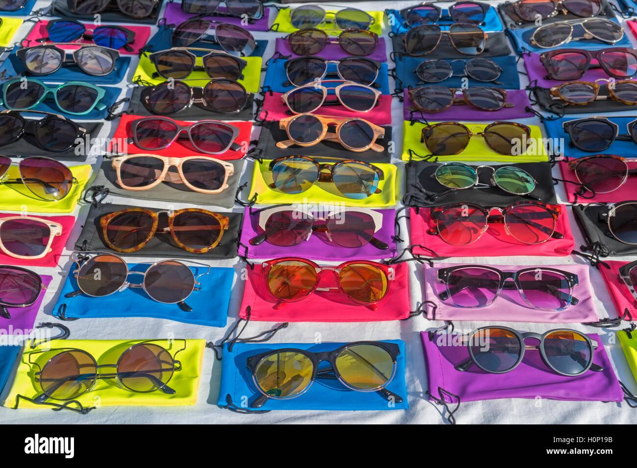 Colourful sunglasses Feira da Ladra Thieves' Market Campo de Santa Clara Lisbon Portugal - Stock Image