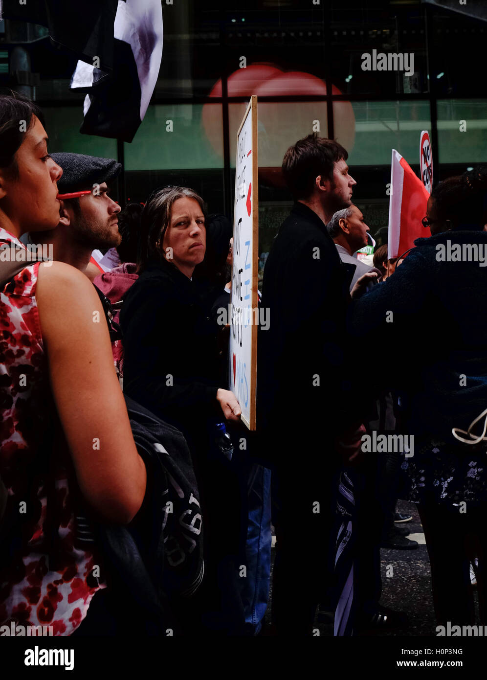 sullen, female protestor at anti-austerity march in London, stares at the camera - Stock Image