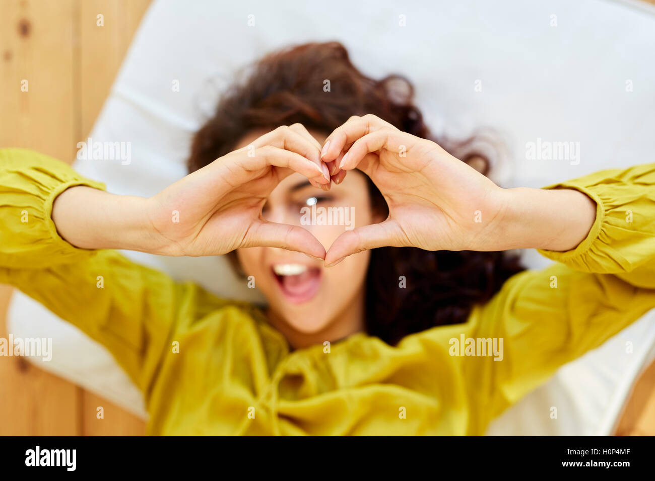 Girl making heart shape with hands - Stock Image