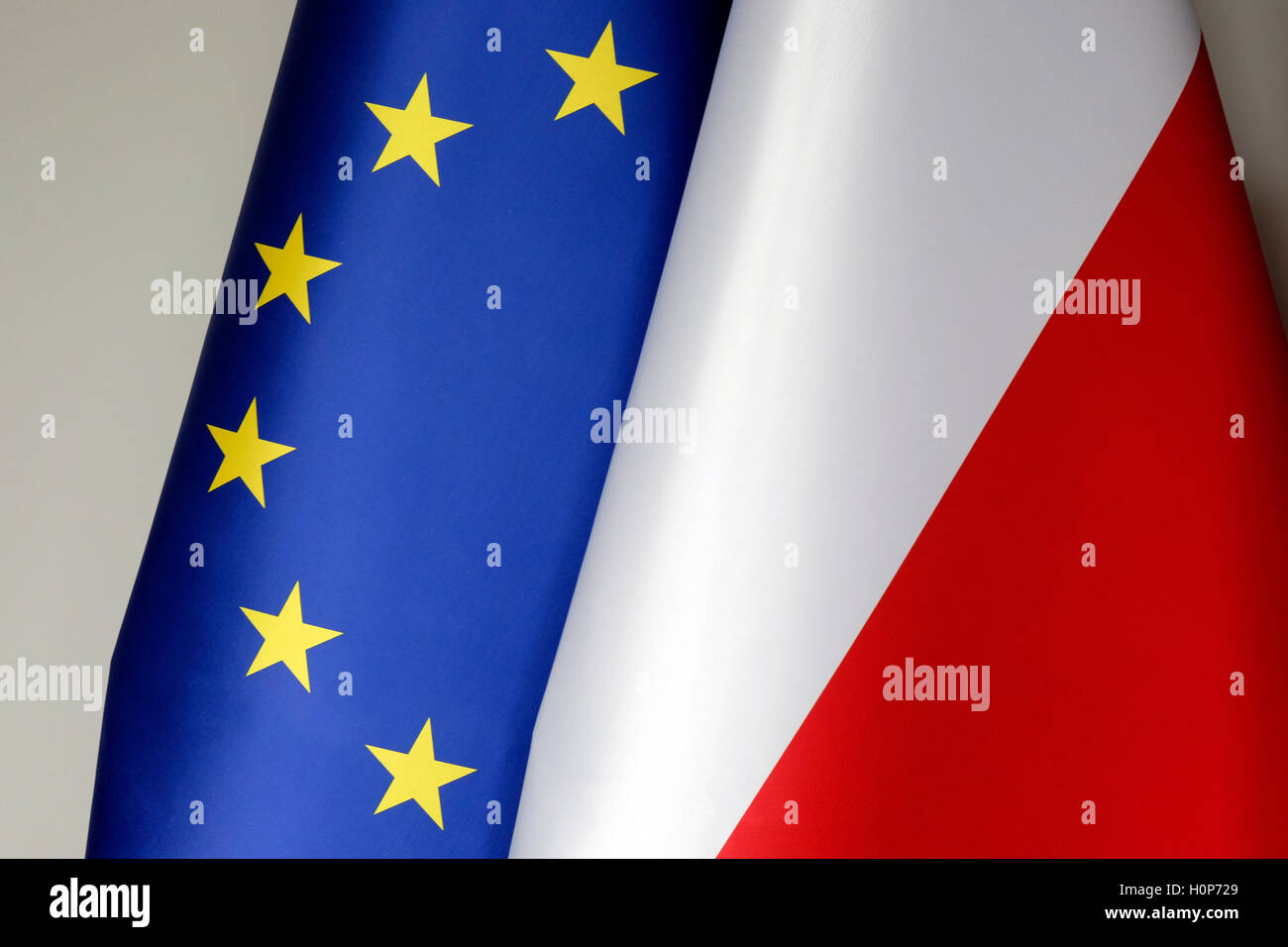 The Polish and the European union flags Stock Photo