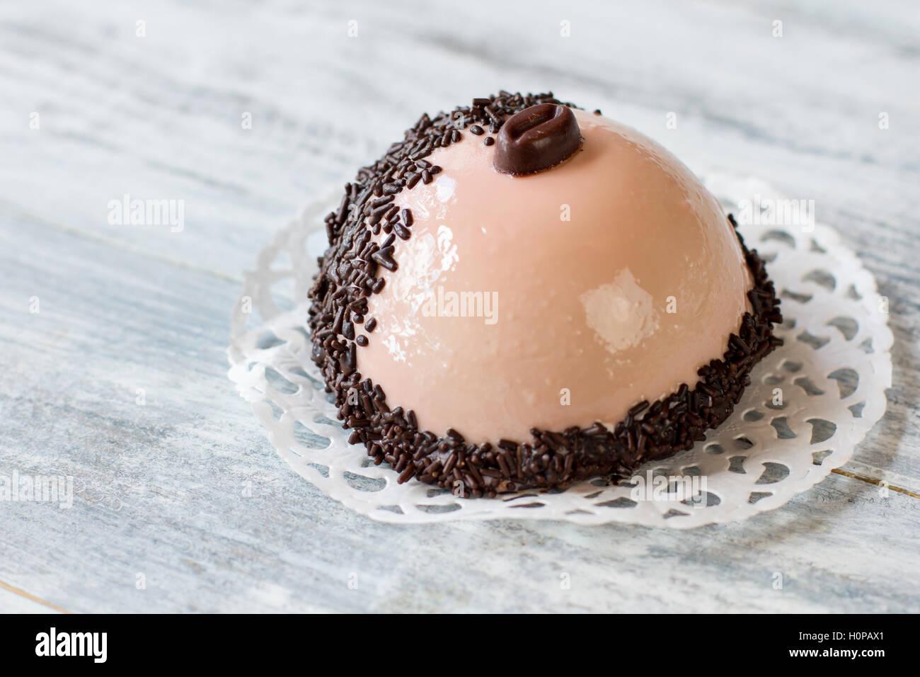 Half sphere dessert with icing. - Stock Image