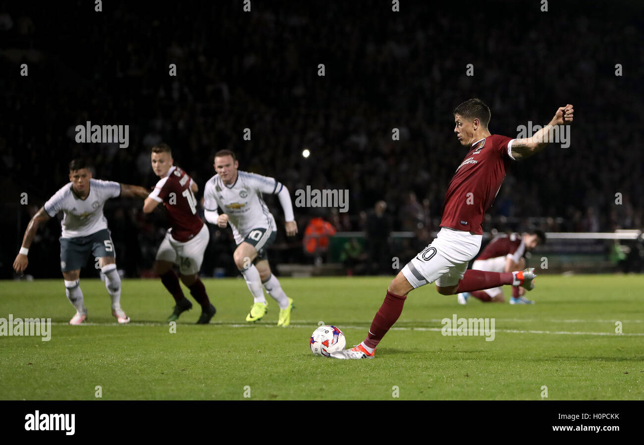 Northampton Town's Alex Revell scores his side's first goal of the game from the penalty spot during the - Stock Image