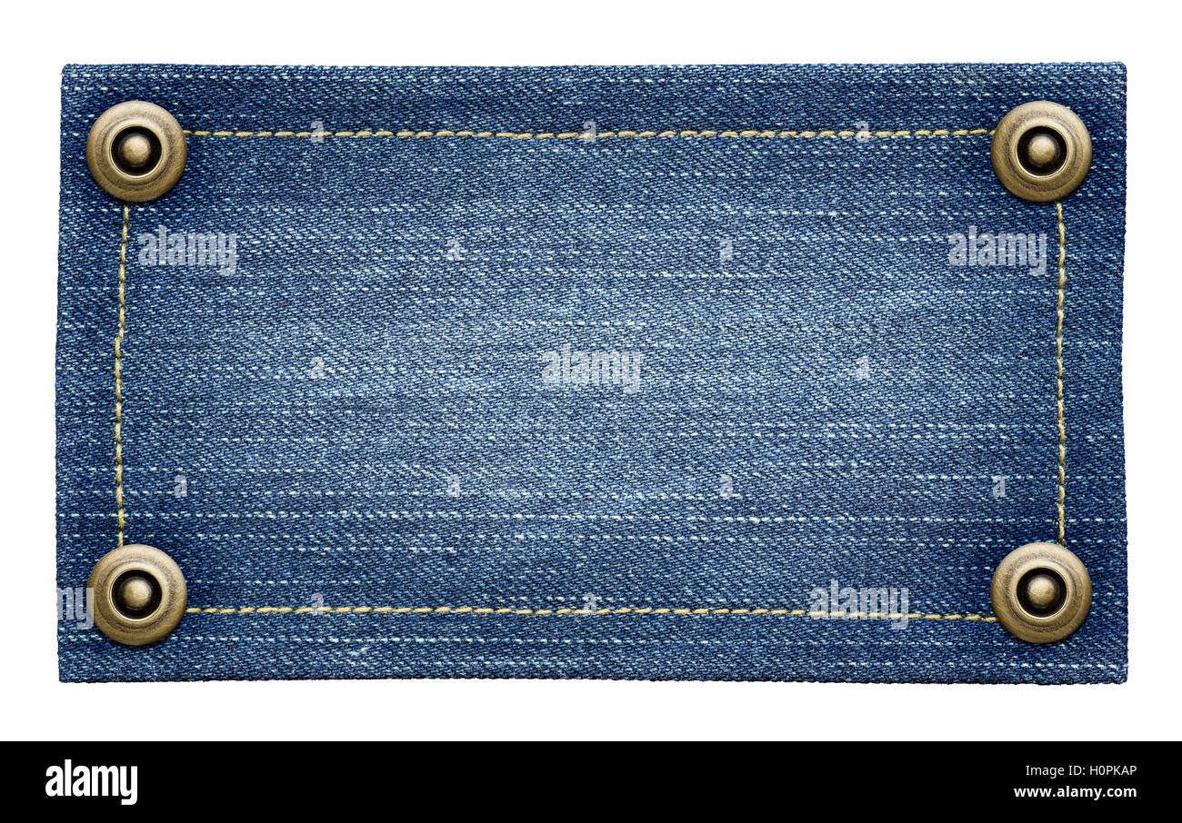 worn blue jeans tag texture isolated denim label with rivets stock