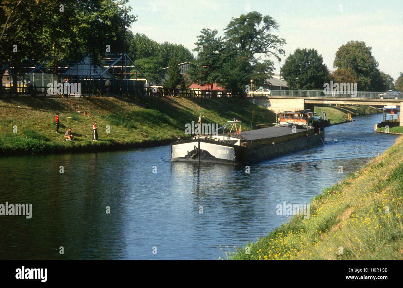RIVER BOAT Sweden on the way with cargo on Europe rivers and canals - Stock Image