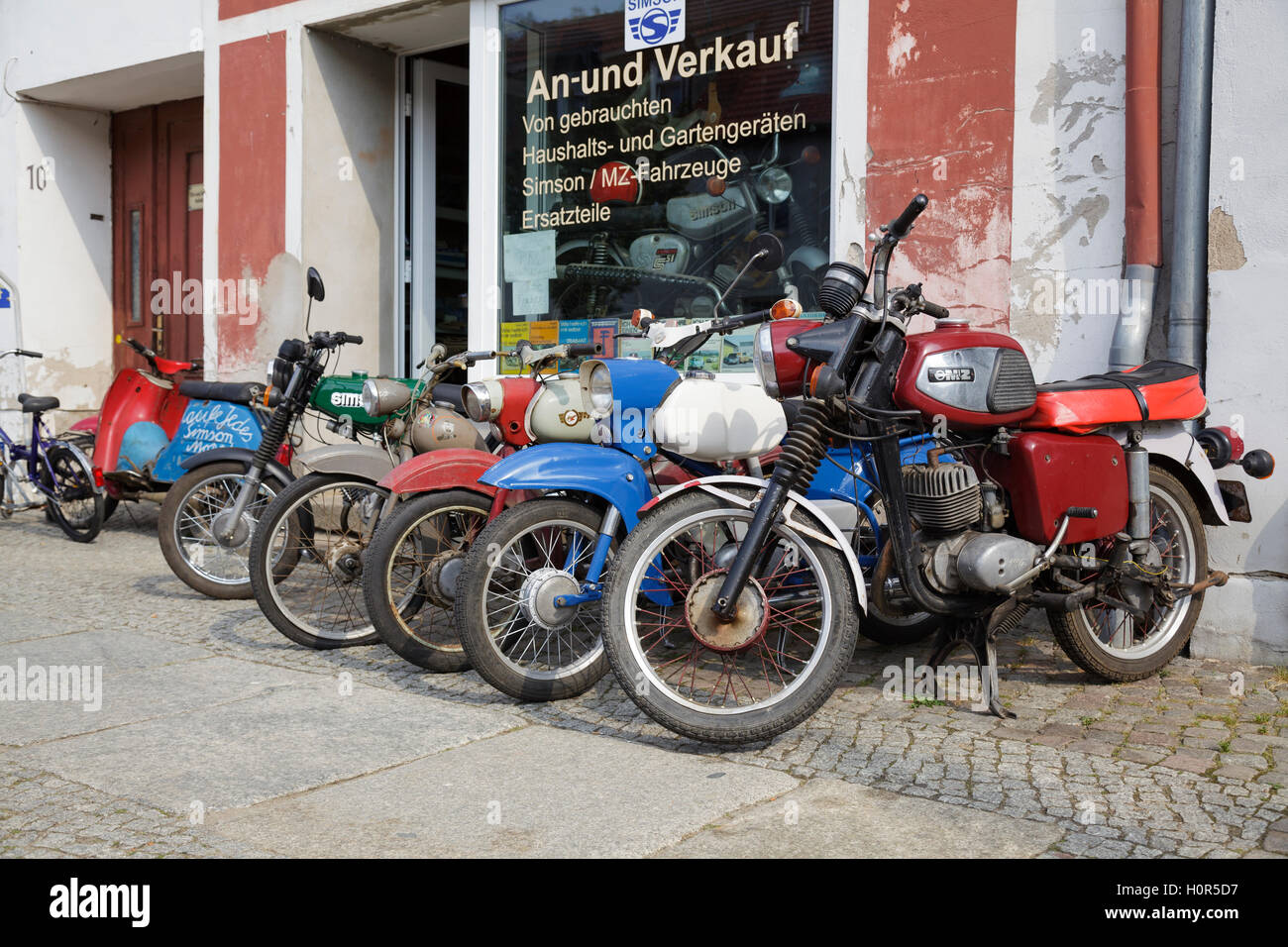 Simson motorbikes for sale outside a shop in Angermünde, Brandenburg, Germany - Stock Image