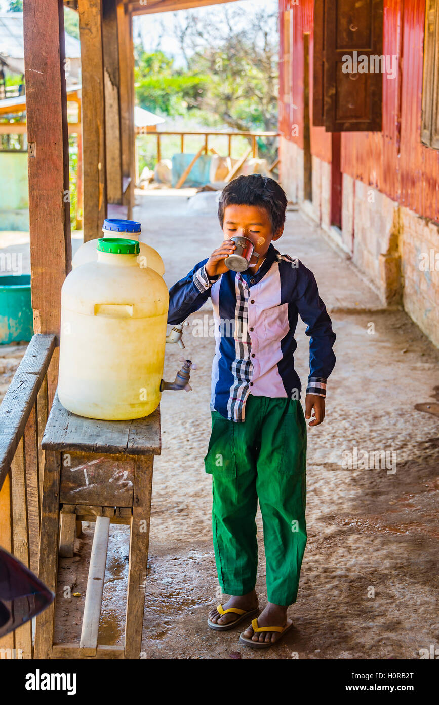 Young boy drinking water, pupil at school, Shan State, Myanmar - Stock Image