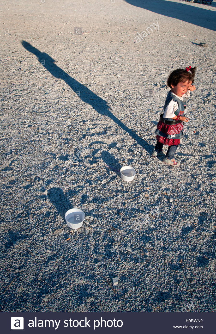 A lone child at Moria Refugee Camp in Lesbos, Greece. - Stock Image