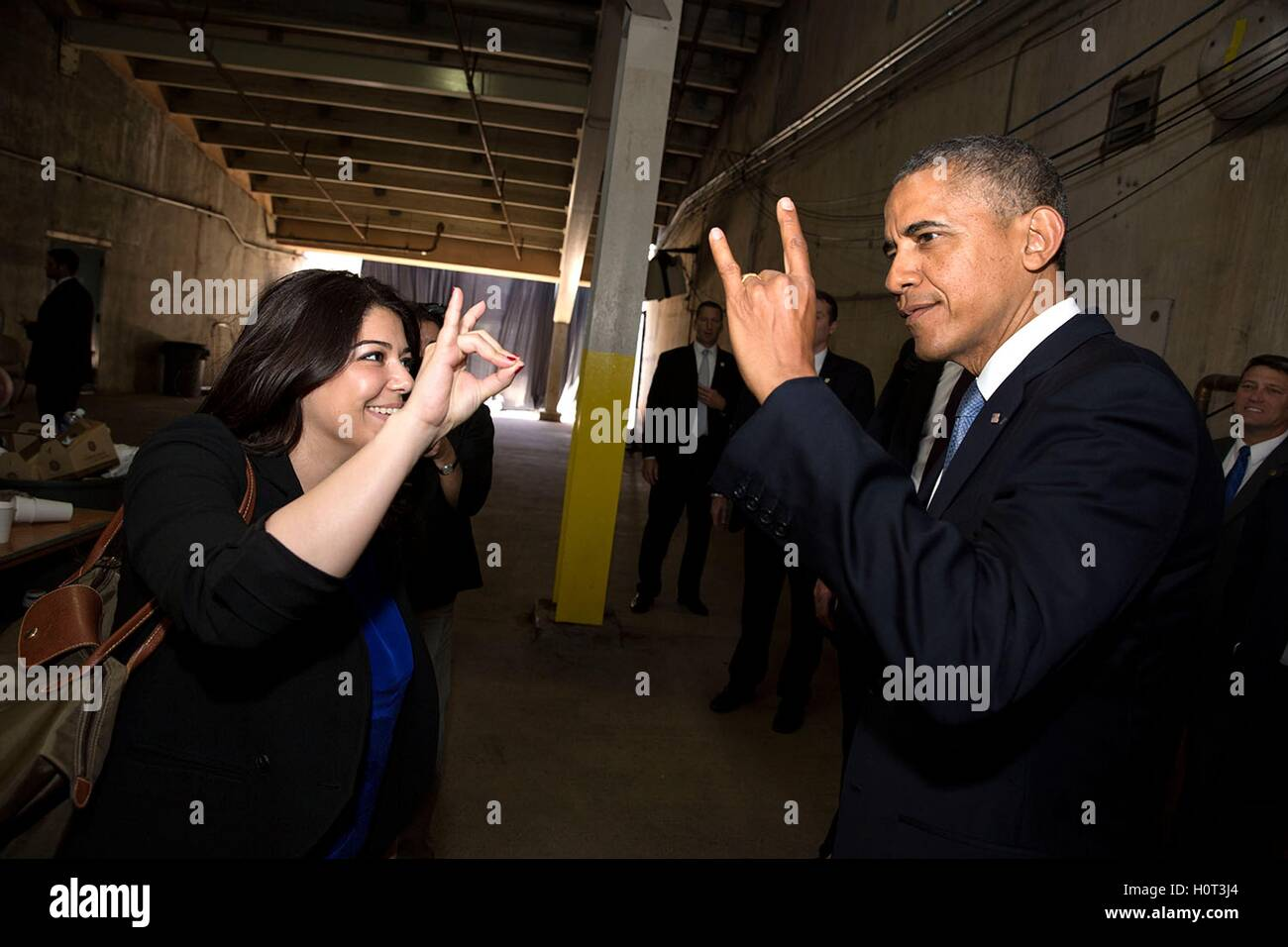 Personal Secretary Ferial Govashiri shows U.S. President Barack Obama the hand sign for the anteater, mascot of - Stock Image