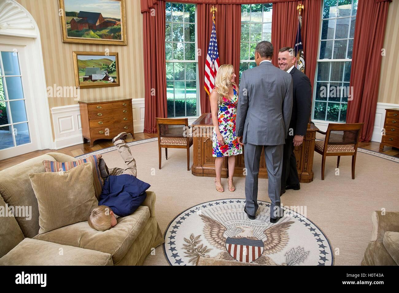 oval office carpet eagle. u.s. president barack obama visits with a departing secret service agent and his family in oval office carpet eagle