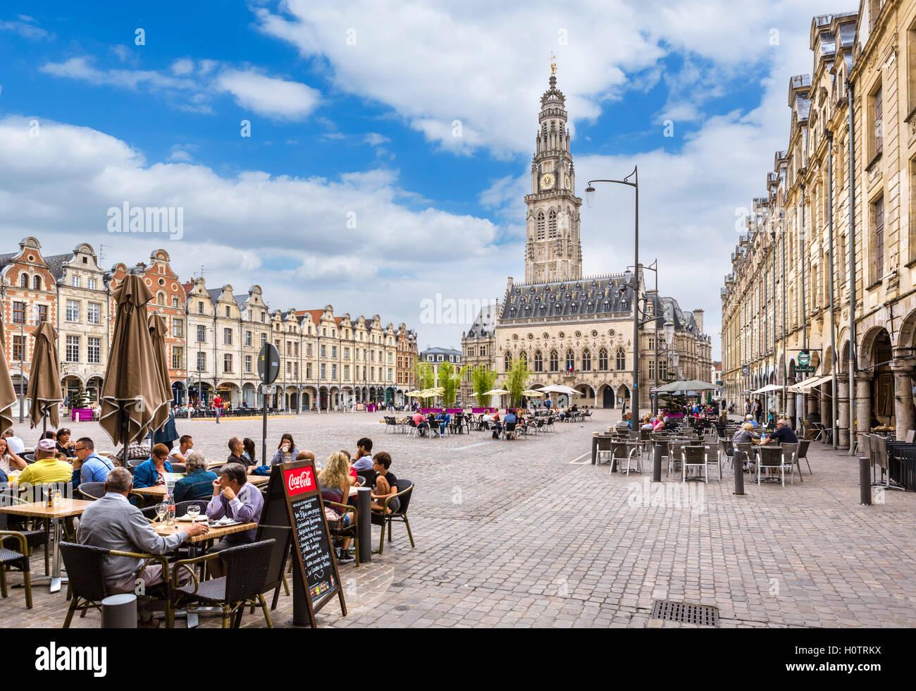 Pavement cafes on La Place des Héros looking towards the Town Hall, Arras, Pas de Calais, France - Stock Image