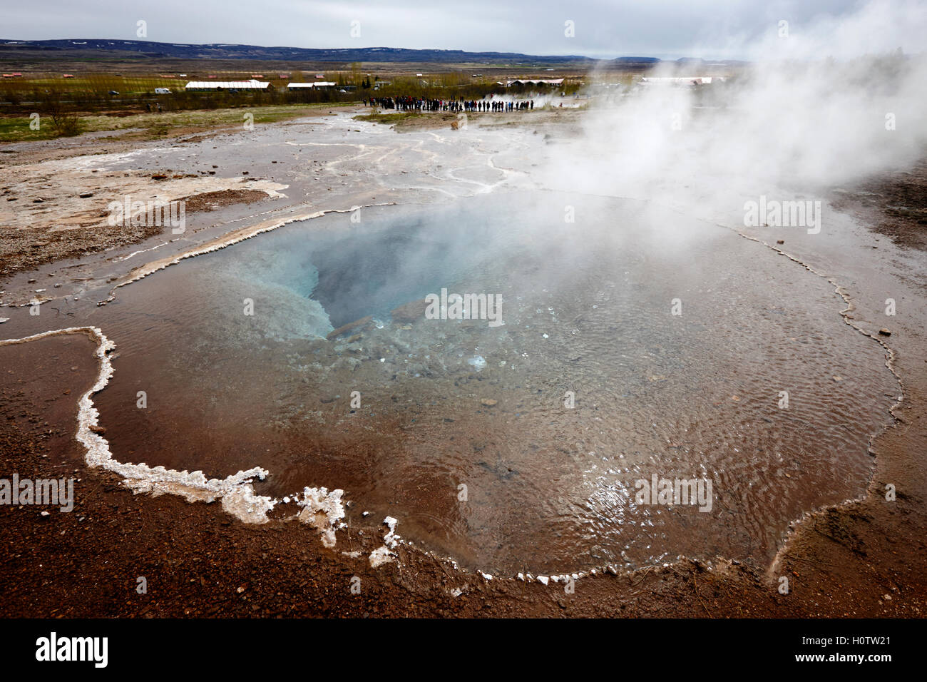 steam rising from the great geyser geysir Iceland - Stock Image
