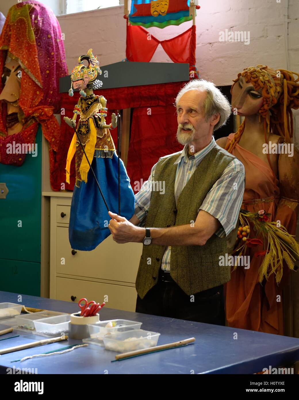 Dr Malcolm Y. Knight, puppeteer at the Scottish Mask and Puppet Centre workshop, Glasgow, Scotland, UK - Stock Image