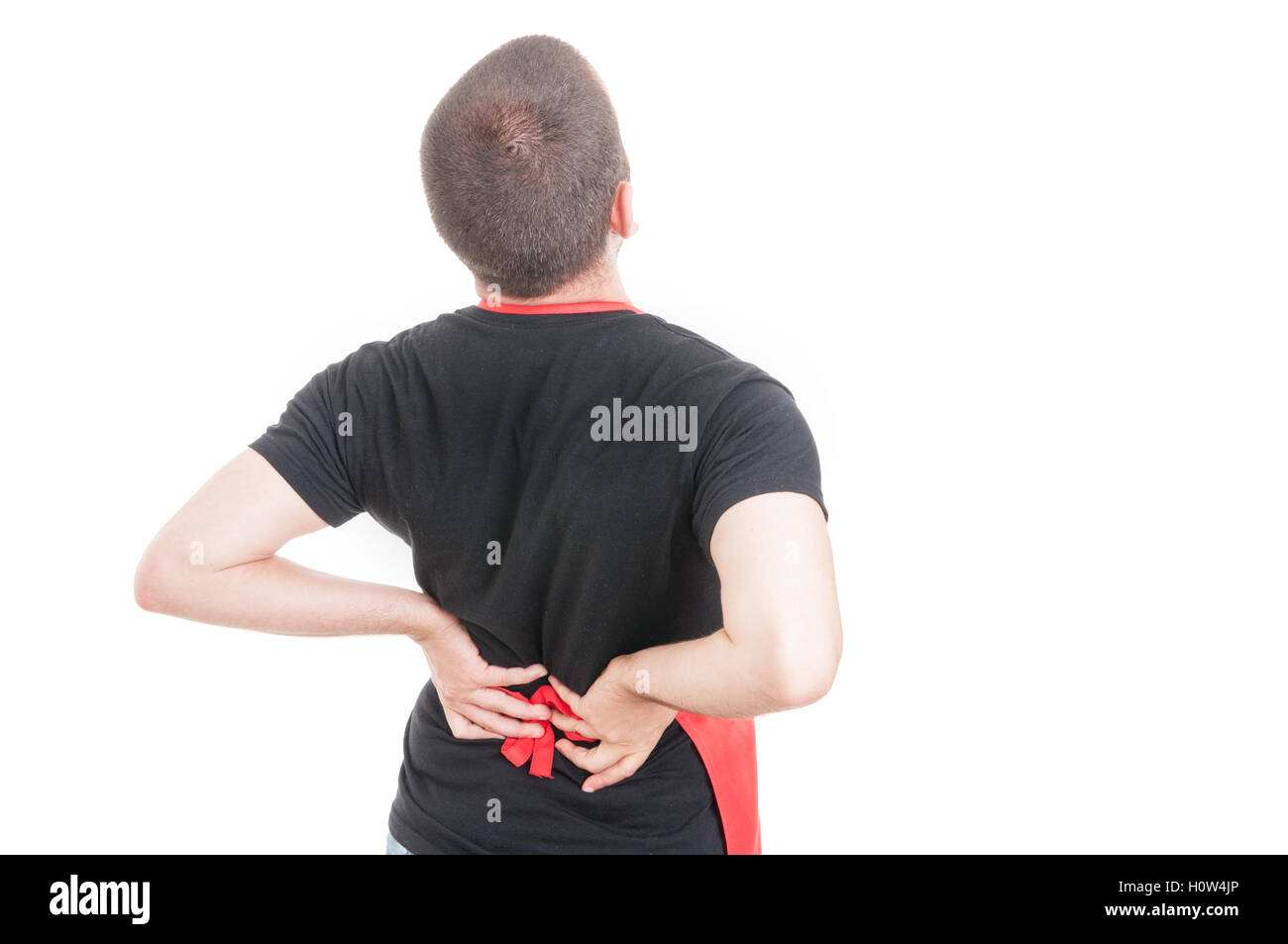 Tired male employee having lumbar or back  pain on white background - Stock Image