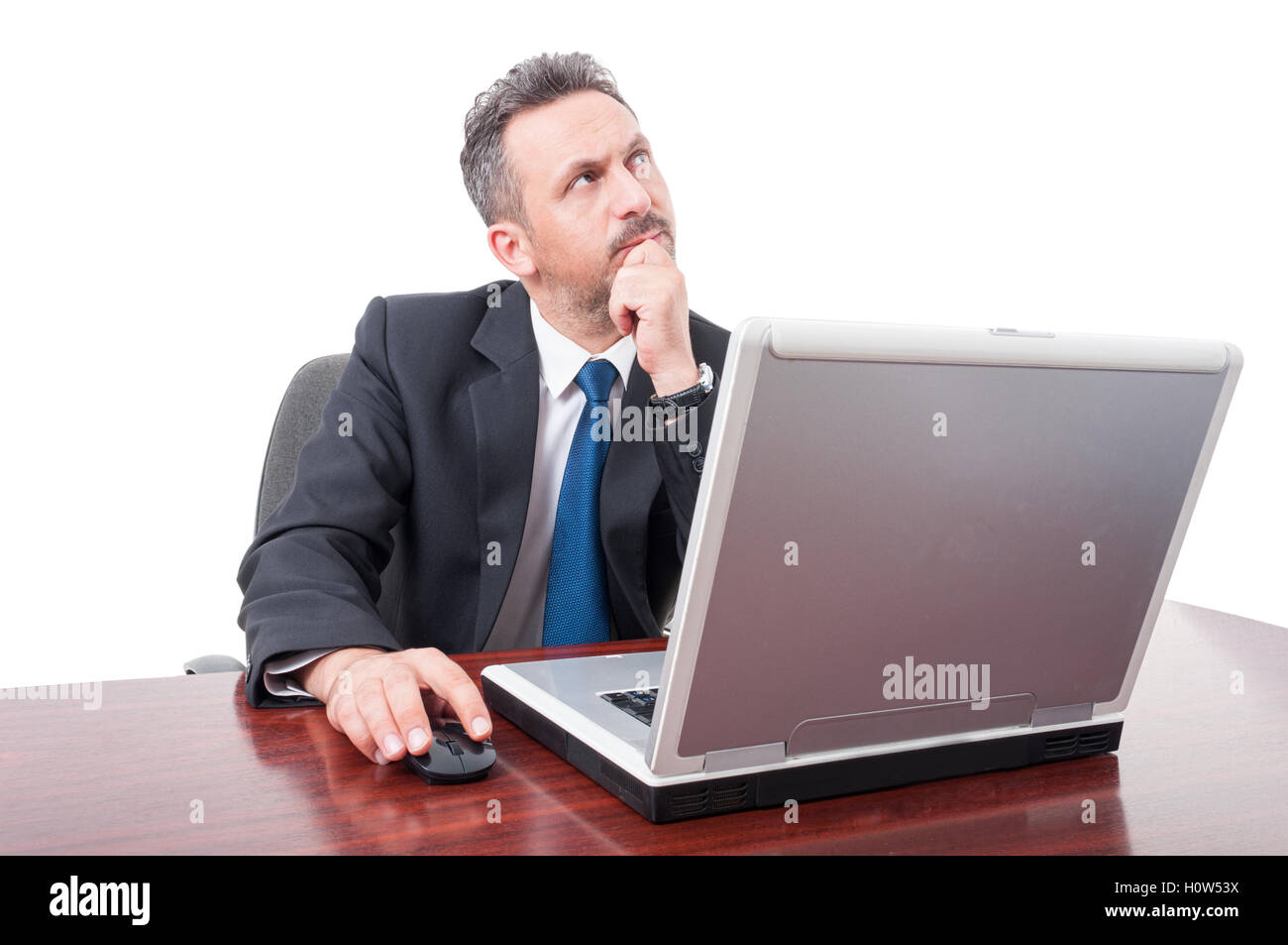Serious broker thinking at some issues while sitting on office on white background - Stock Image