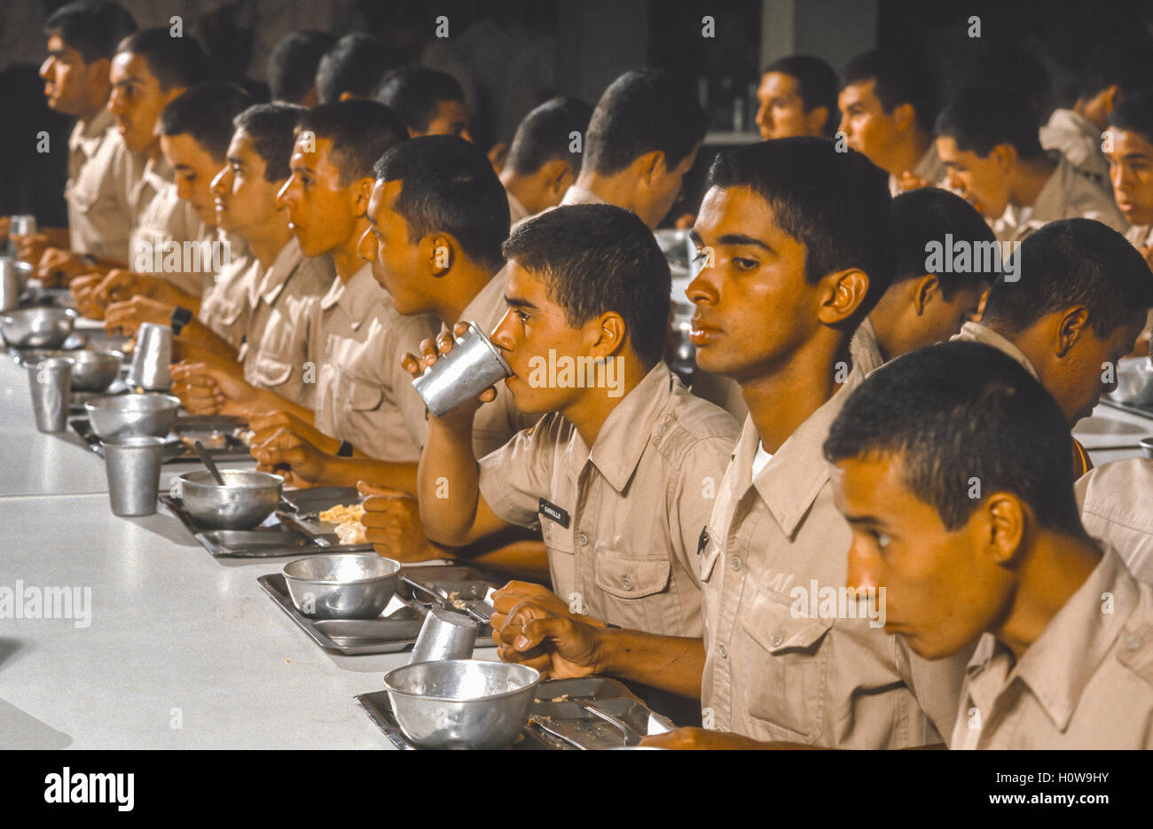 CORDERO, TACHIRA STATE, VENEZUELA - Cadets eating lunch in mess hall at National Guard Academy in May 1988. - Stock Image