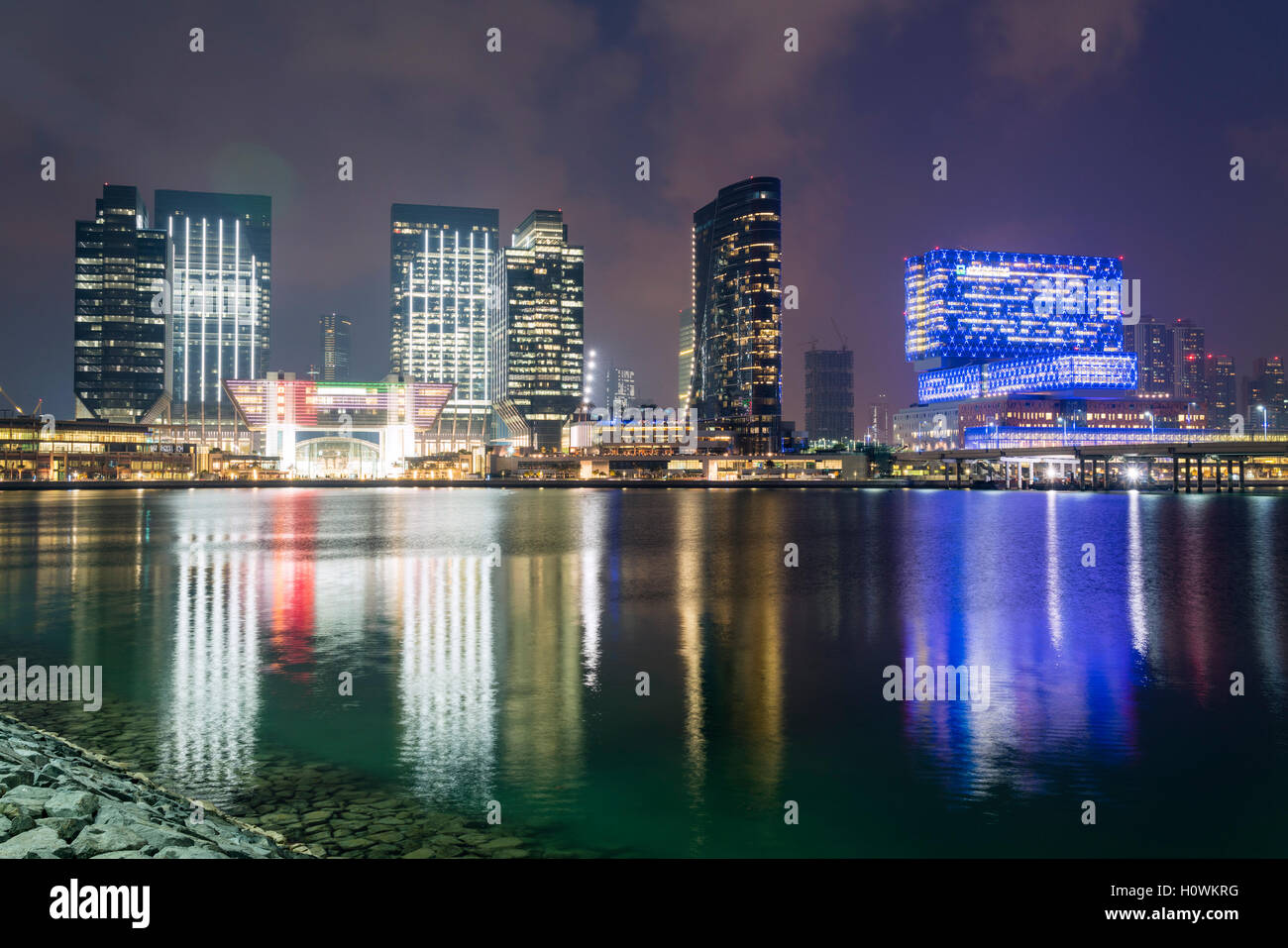 Night view of ADGM, Abu Dhabi Global Market modern business and commercial district on Al Maryah Island, Abu Dhabi, - Stock Image