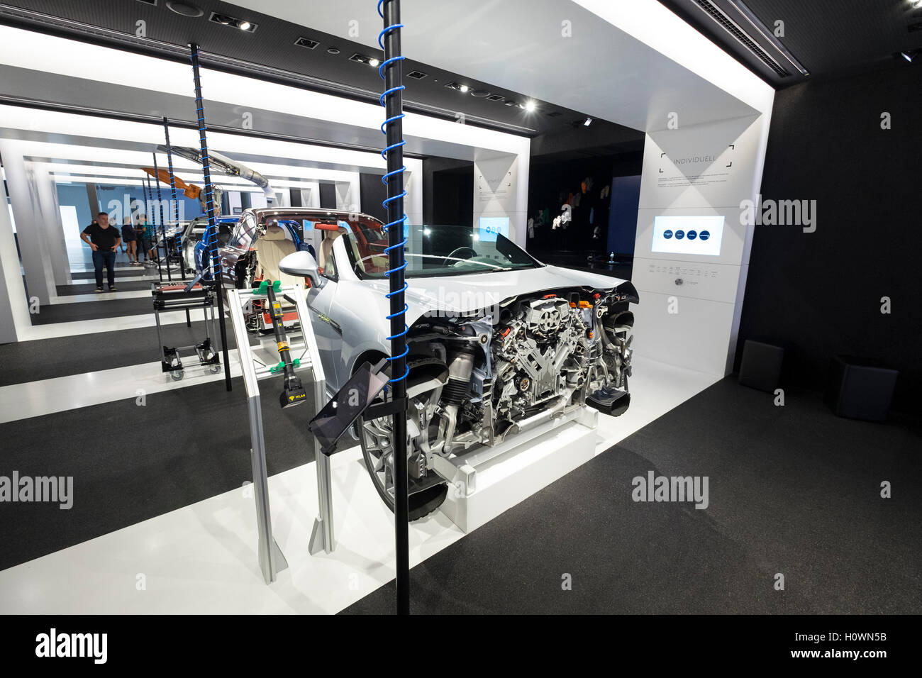 Display of modern car manufacture and assembly production line at VW Volkswagen Visitor Centre at Autostadt in Wolfsburg, - Stock Image