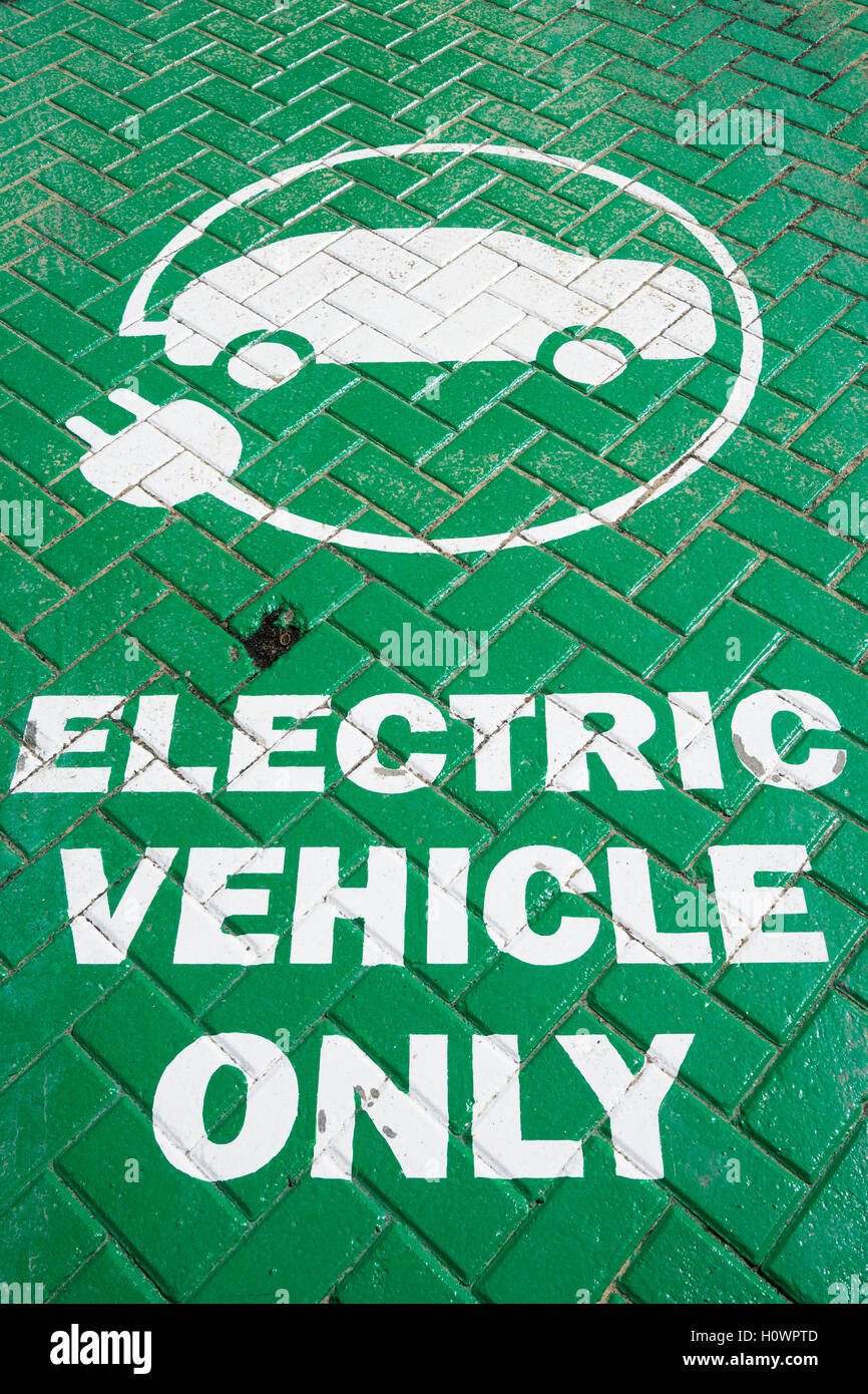 Sign on parking bay at electric vehicle charging point - Stock Image