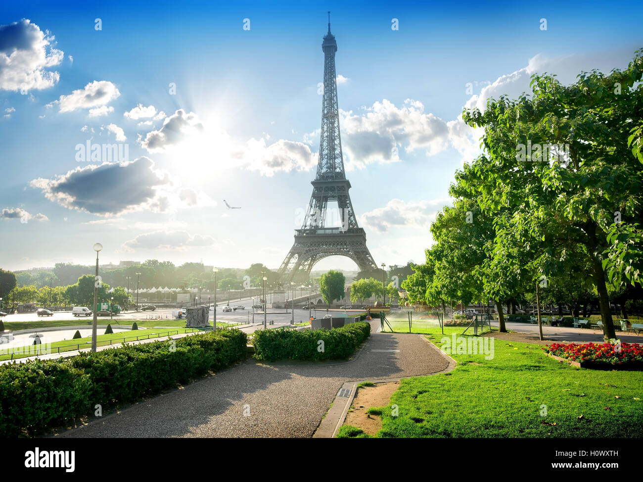 Eiffel tower near green park in Paris, France - Stock Image