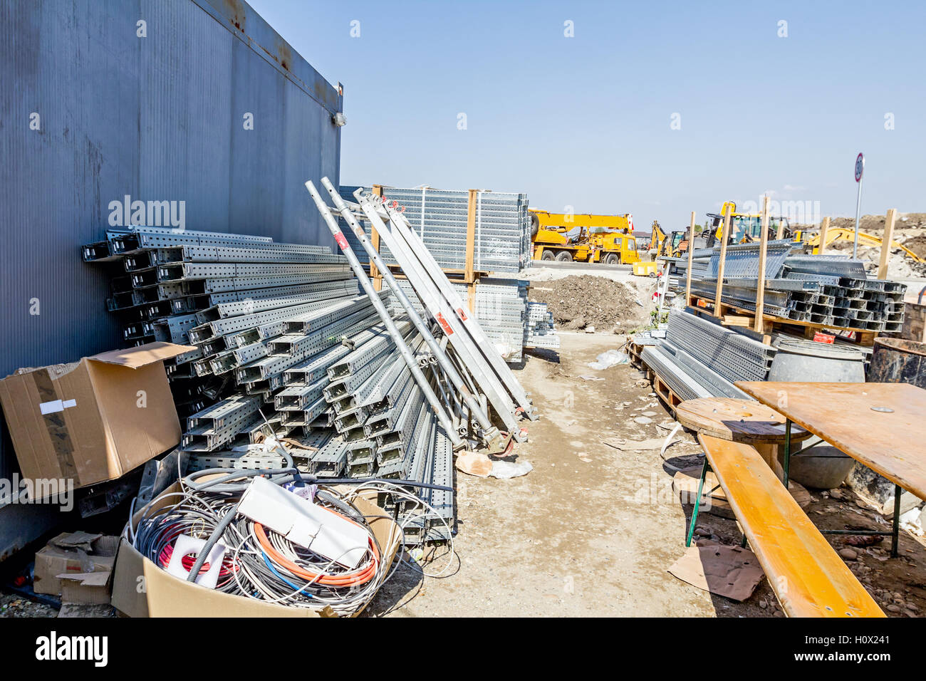 Cable trays for different usage at construction site in the improvised warehouse. - Stock Image
