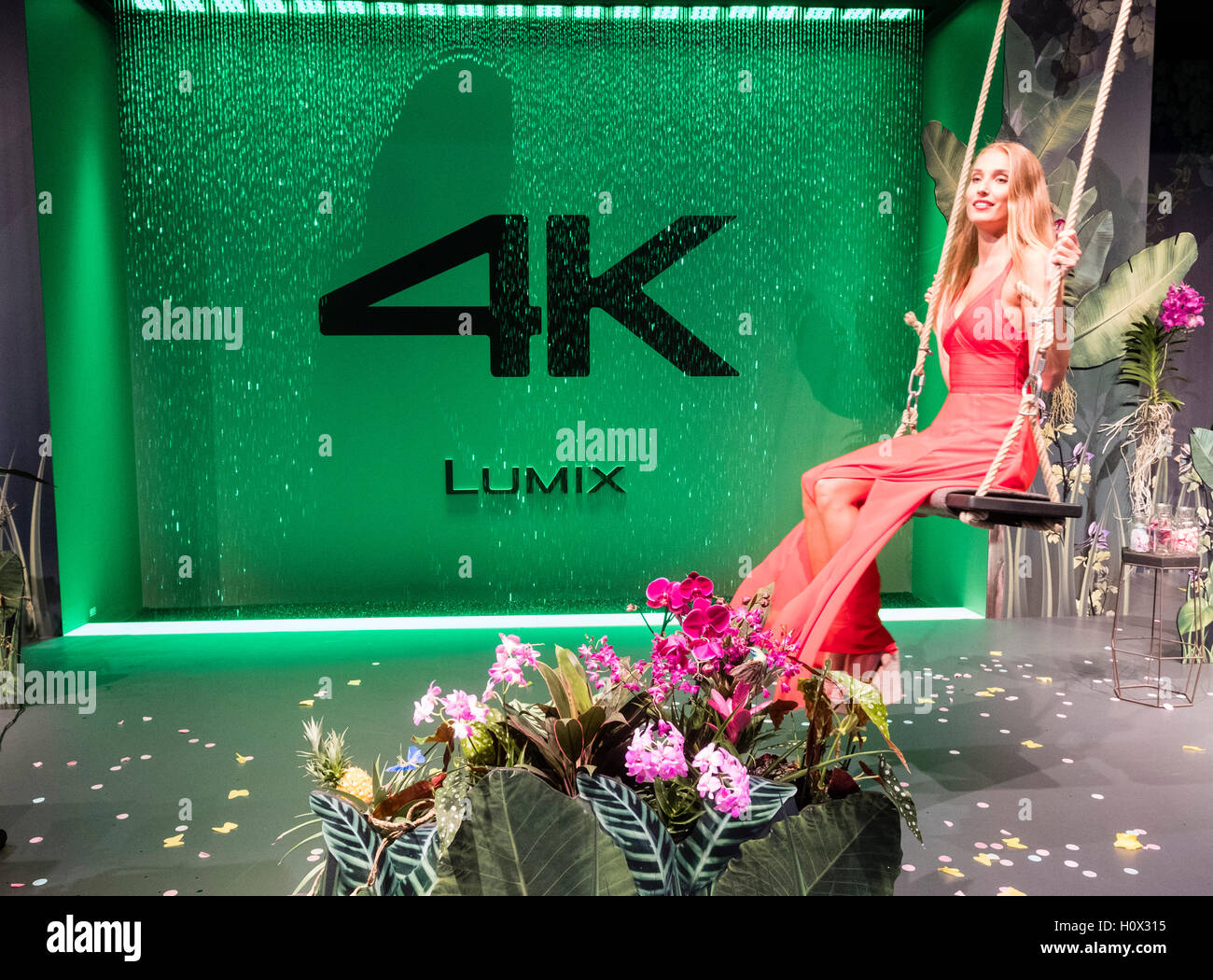 Panasonic Lumix 4K video exhibit with model at Photokina trade fair in Cologne, Germany , 2016 - Stock Image
