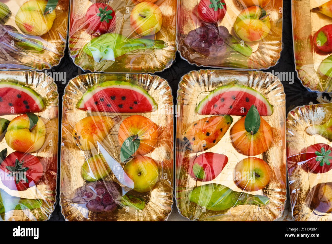 Marzipan fruits on a market stall, Sicily - Stock Image