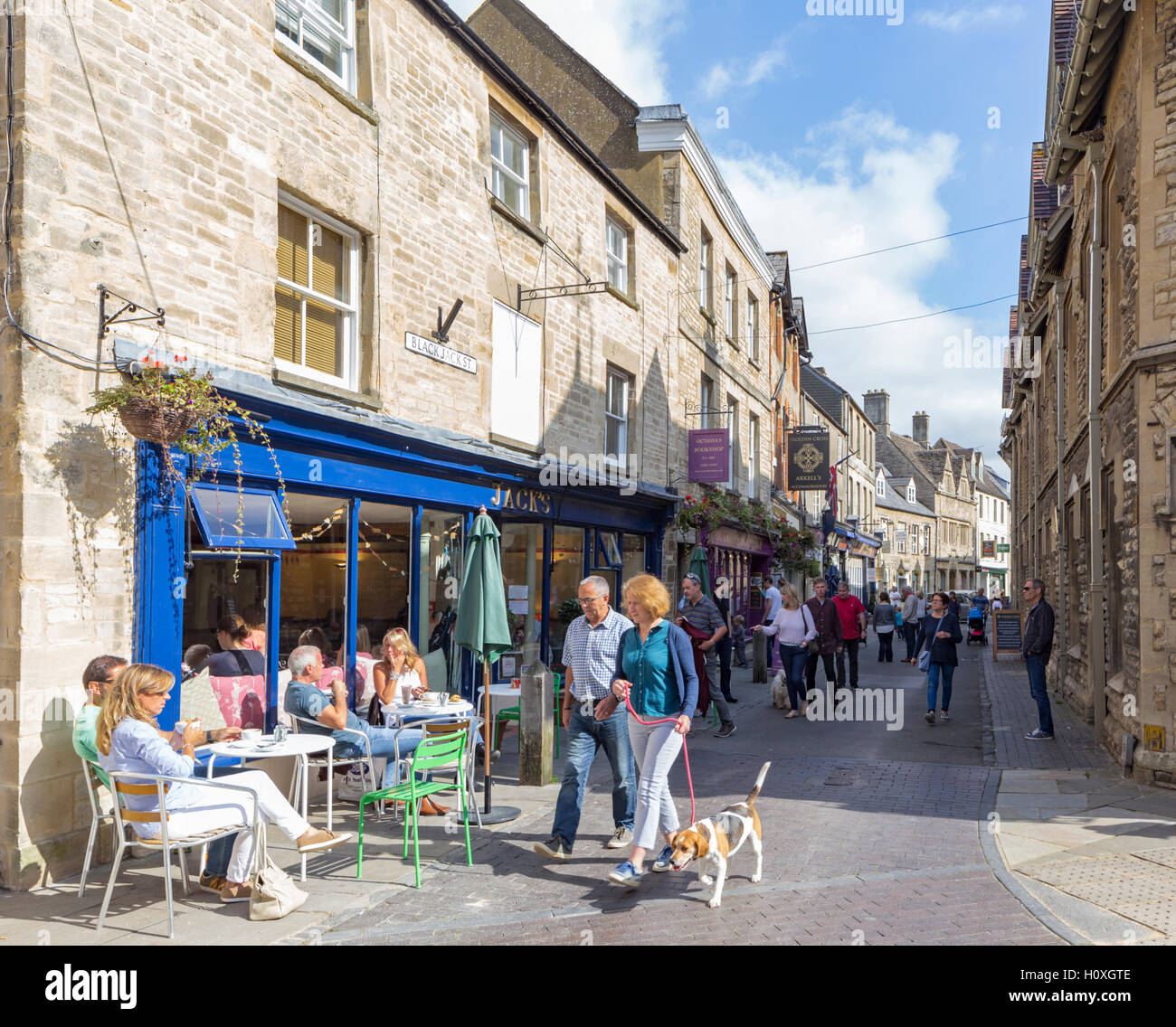 Attractive shops and cafe in the Cotswold town of Cirencester, Gloucestershire England, UK - Stock Image