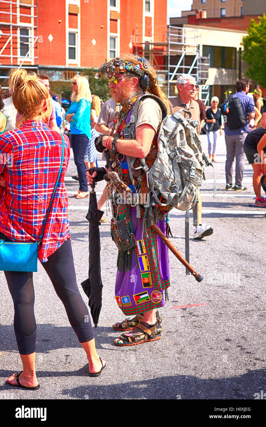 Aging hippy man standing with the anti-Trump supporters in Asheville, NC - Stock Image