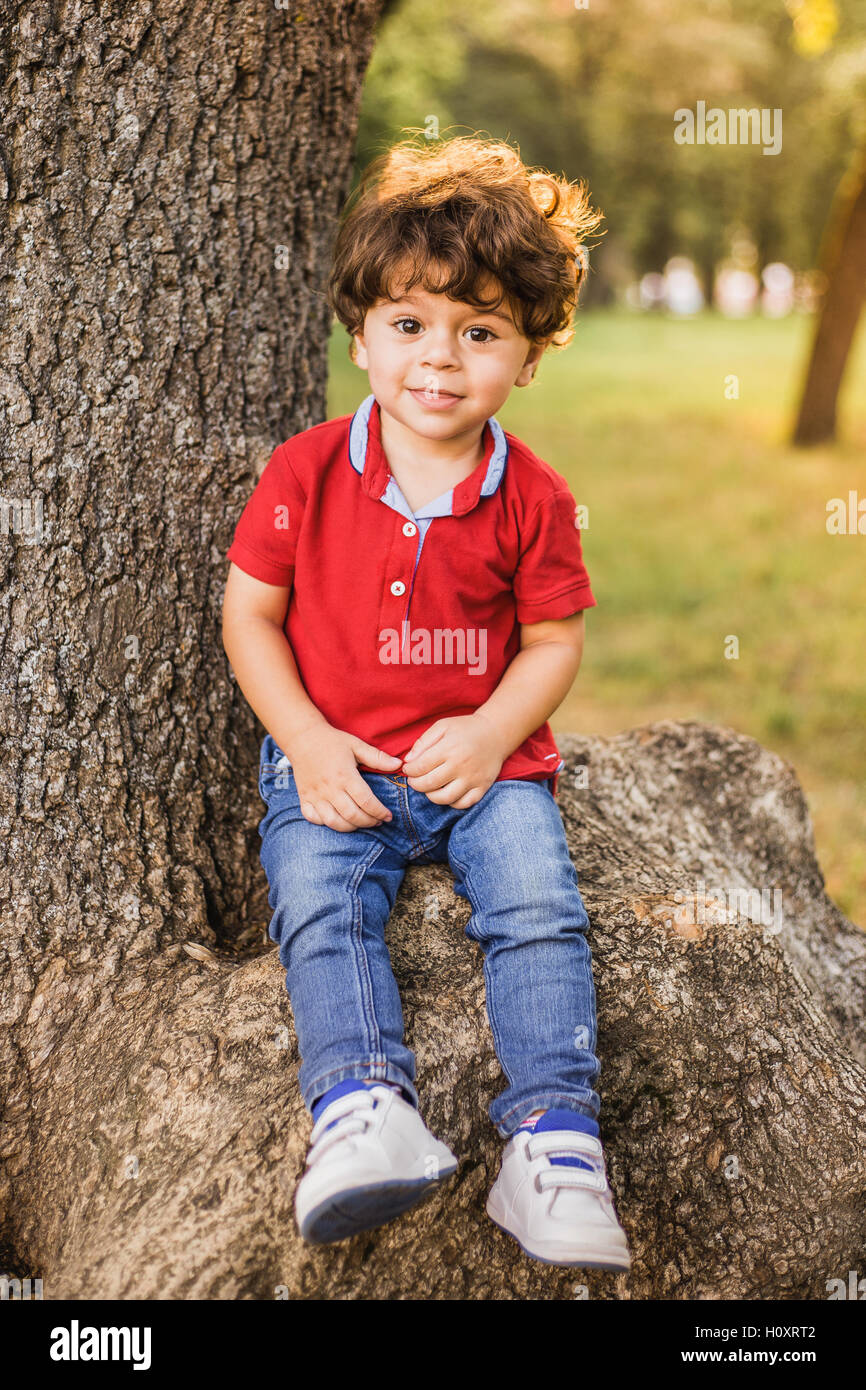 Little boy playing in the park. Portrait - Stock Image