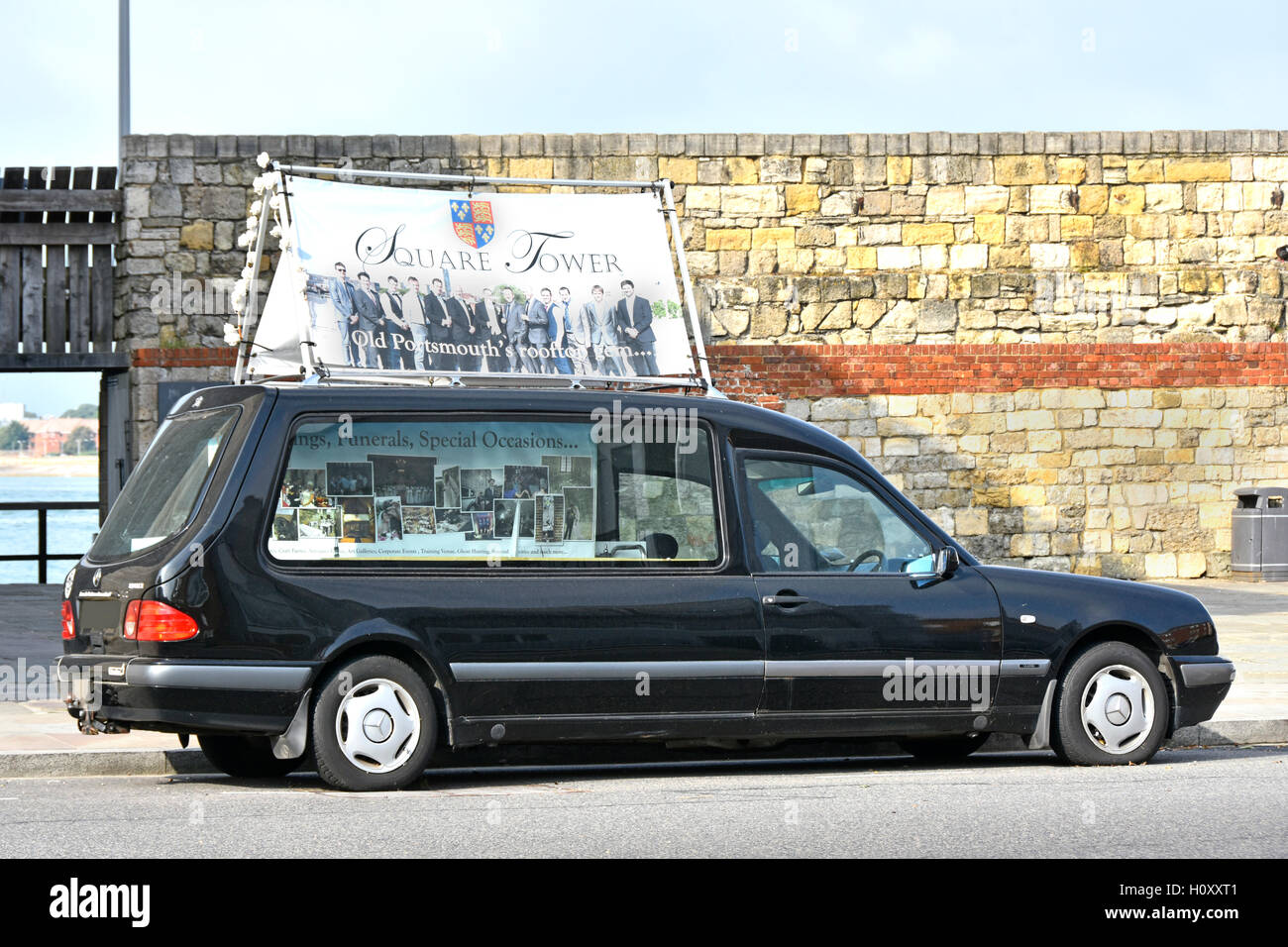 Portsmouth England UK Hearse with adverts to promote events that can be hosted at the adjacent Tudor 'Square - Stock Image