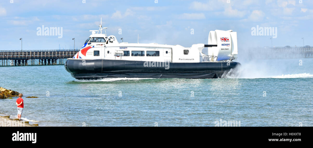 Public transport by Hovercraft GH-2161 'Island Flyer' arriving at Ryde Isle of Wight England UK with spectator - Stock Image