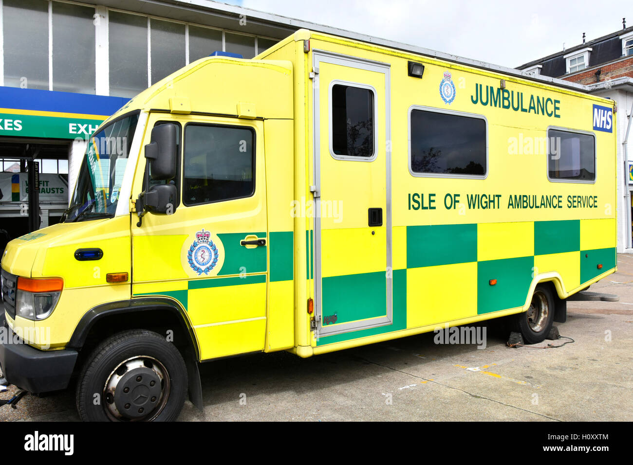 Newport Isle of Wight England UK unusual NHS emergency Ambulance Service Jumbulance parked at a garage having wheels - Stock Image