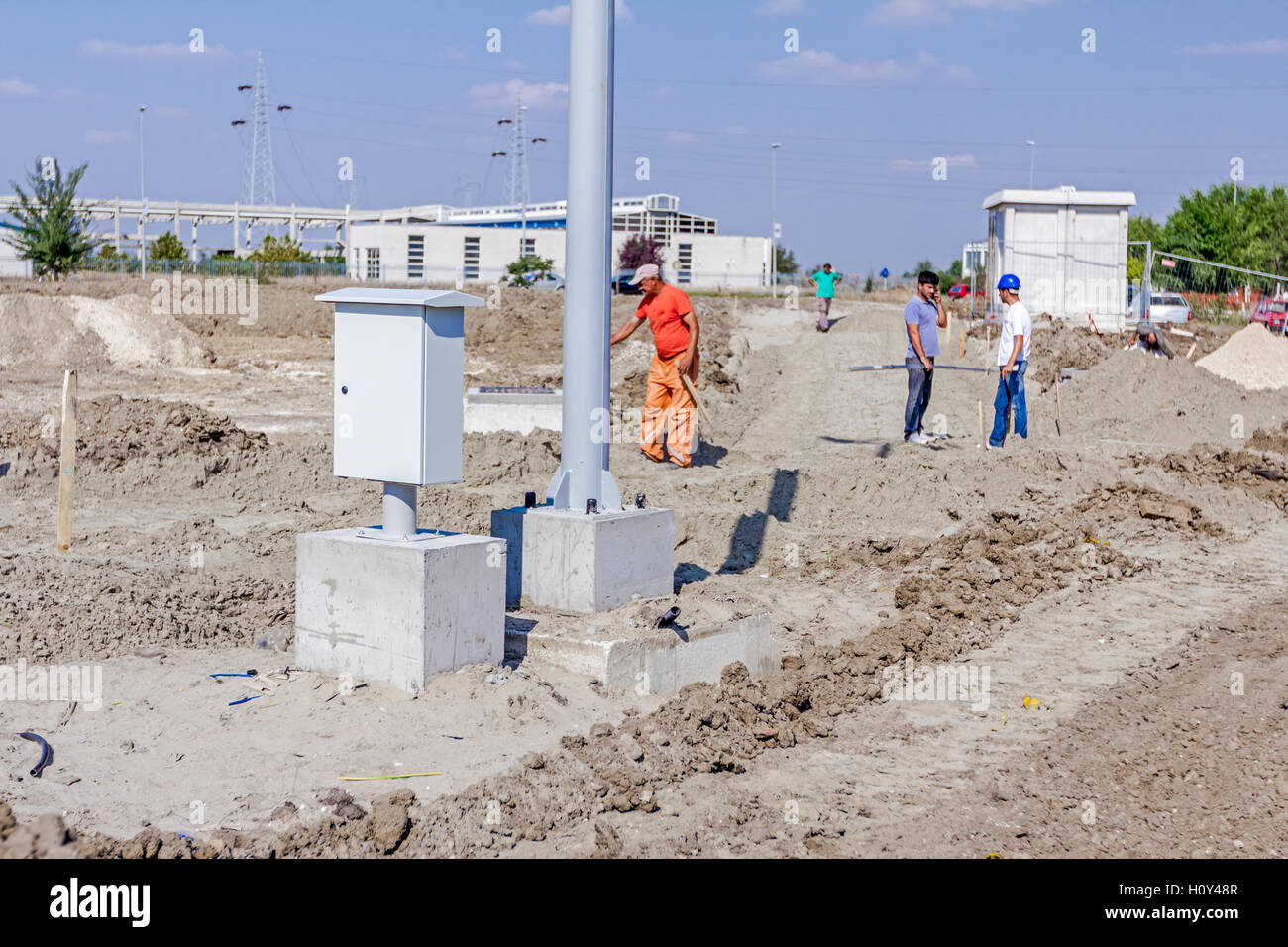 New small distribution fuse box on construction site next to the pole base. Stock Photo
